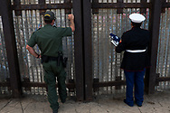 U.S. Marine Corps and Vietnam War veteran Manuel Valenzuela, right, visits the U.S.-Mexico border as he speaks with deported U.S. military veterans in Tijuana through a metal fence in San Diego, California, Sunday, September 30, 2018.<br /> <br /> Valenzuela and his older brother Valente, a U.S. Army and Vietnam War veteran, have been fighting deportation since 2009 for misdemeanor offenses which they completed sentences for.
