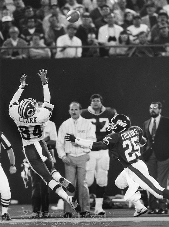 Washington Redskins wide receiver Gary Clark (84) leaps in vain for a pass from quarterback Doug Williams while New York Giants cornerback Mark Collins defends during the third quarter of an NFL football game, Monday, Sept. 5, 1988 at Giants Stadium in East Rutherford, N.J. The Giants won, 27-20. (D. Ross Cameron/The Express)