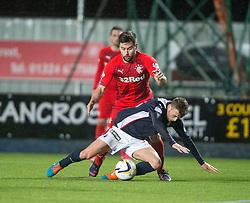 Rangers Derek McGregor tackles Falkirk's Rory Loy. Falkirk 1 v 1 Rangers, Scottish Championship game played 27/2/2014 at The Falkirk Stadium .