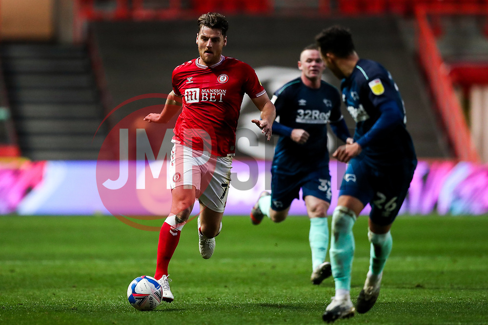 Chris Martin of Bristol City is challenged by Lee Buchanan of Derby County - Rogan/JMP - 21/11/2020 - Ashton Gate Stadium - Bristol, England - Bristol City v Derby County - Sky Bet Championship.