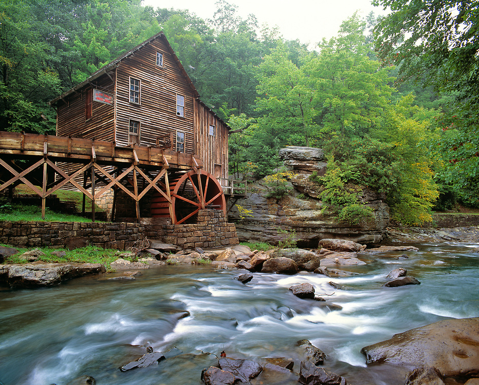 Rustic Glade Creek Grist Mill sits quietly overlooking the water in in Babcock State Park, West Virginia.