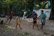 Children playing by the railway lines on 9th June 2018 in Jakarta, Java, Indonesia.
