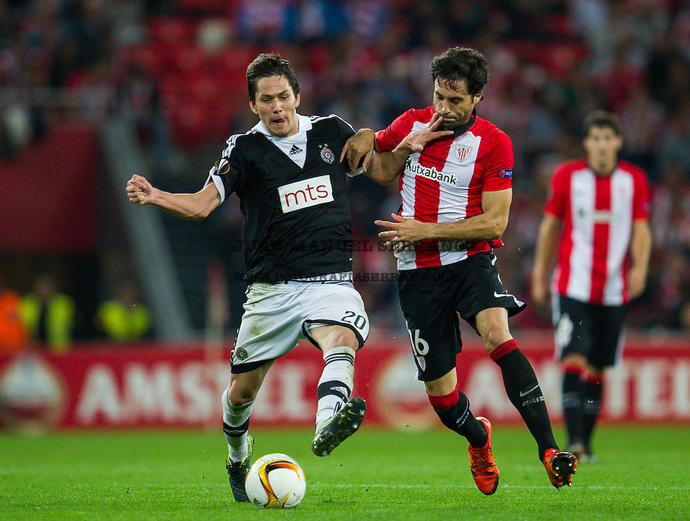 BILBAO, SPAIN - NOVEMBER 05: Xabier Etxeita of Athletic Club duels for the ball with Sasa Lukic of FK Partizan during the UEFA Europa League match between Athletic Club and FK Partizan at San Mames Stadium on November 5, 2015 in Bilbao, Spain.  (Photo by Juan Manuel Serrano Arce/Getty Images)