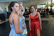 Allie Smith, Destani Nowland and Julia Alexander talk on the dance floor as Fairdale High School holds it's prom at the Muhammad Ali Center on Saturday, May 18.