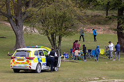Licensed to London News Pictures. 03/05/2021. London, UK. Police patrol the parks as members of the public brave the wind and rain as they enjoy a Bank Holiday Monday picnic in Richmond Park, South West London. Today, weather forecasters predict high winds and driving rain with temperatures reaching 13c in London and the South East. Yesterday, Health Secretary Dominic Rabb admitted that masks could be with us for the summer as virtually all social restrictions will be lifted by June 21 2021. Photo credit: Alex Lentati/LNP