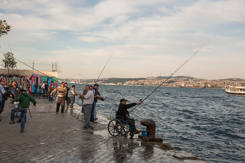 Men fishing in the Golden Horn in Istanbul, Turkey.<br /> <br /> Matt Lutton for the European Commission