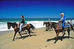 Sarah Borrey & Ione Rice Riding Horses On Beach