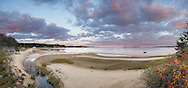 As the sun sets in the west, the clouds in the eastern sky are lit from below in this panoramic image of Pleasant Bay in South Orleans.