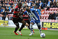 Wigan Athletic's Marc-Antoine Fortune shields the ball from Queens Park Rangers Nedum Onuoha. Skybet football league championship play off semi final, 1st leg match, Wigan Athletic v QPR at the DW Stadium in Wigan, England on Friday 9th May 2014.<br /> pic by Chris Stading, Andrew Orchard sports photography.