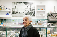 SANTA MARIA DI CASTELLABATE (CASTELLABATE), ITALY - 14 FEBRUARY 2018: Giuseppina Izzo (90), owner of Ristobar Marina, poses for a portrait in her small business in Santa Maria di Castellabate (Castellabate), Italy, on February 14th 2018.<br /> <br /> Santa Marina di Castellabate is part of the electoral college of Agropoli, in the Campania region (southern Italy) in which Franco Alfieri (Democratic Party, PD, Partito Democratico), politically active for the past 30 years, is running agains the 28-years old Alessia d'Alessandro (Five Stars Movement, M5S, Movimento 5 Stelle).<br /> <br /> The 2018 Italian general election is due to be held on 4 March 2018 after the Italian Parliament was dissolved by President Sergio Mattarella on 28 December 2017.<br /> Voters will elect the 630 members of the Chamber of Deputies and the 315 elective members of the Senate of the Republic for the 18th legislature of the Republic of Italy, since 1948.Santa<br /> <br /> The 2018 Italian general election is due to be held on 4 March 2018 after the Italian Parliament was dissolved by President Sergio Mattarella on 28 December 2017.<br /> Voters will elect the 630 members of the Chamber of Deputies and the 315 elective members of the Senate of the Republic for the 18th legislature of the Republic of Italy, since 1948.