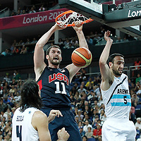 10 August 2012: USA Kevin Love dunks the ball during 109-80 Team USA victory over Team Argentina, during the men's basketball semi-finals, at the North Greenwich Arena, in London, Great Britain.