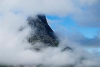 Norwegian mountain rising into clouds