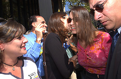 María Corina Machado, a representative of the organization Sumate,  speaks with local reporters before walking into a Prosecutor's  office in Caracas, Venezuela on Thursday June 10,2004 to formally hear that she is being charged with treason. Sumate, one of a handful of organizations to receive funding from the National Endowment for Democracy(NED), was instrumental in the organization and follow through a various petition drives seeking a presidential referendum.  President Chavez claims that the NEDs funding of these organizations is a clear sign that the US government is helping to overthrow his government.  Though there are some organizations that have received money that members of Chavez's own MVR political party claim are doing productive work that benefit the country.