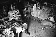 JAACH, SUDAN - JANUARY 11, 2008: A Sudanese woman in her home. Located in the southern Darfur region, Jaach is home to many internally displaced Sudanese fleeing conflict.
