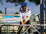 09 SEPTEMBER 2016 - BANGKOK, THAILAND:  A worker ties a Khlong Phadung Krung Kasem passenger boat to a pier. Trial services have started on a 5-kilometre boat route on Khlong Phadung Krung Kasem between Hua Lamphong and Thewes piers. The service is operated by the Bangkok Metropolitan Administration (BMA). The city is using converted garbage boats, fitted with seats, awnings and life preservers. If the trial run is successful regular passenger boats will be put on the route.      PHOTO BY JACK KURTZ