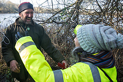 Harefield, UK. 18 January, 2020. Save the Colne Valley activist Mark Keir welcomes fellow activists from Stop HS2 and Extinction Rebellion as they reoccupy the Colne Valley wildlife protection camp on the second day of a three-day 'Stand for the Trees' event in the Colne Valley timed to coincide with tree felling work by HS2. Bailiffs acting for HS2 had evicted all but two activists from the camp over the past week and a half, one of which was Mark Keir. 108 ancient woodlands are set to be destroyed by the high-speed rail link.