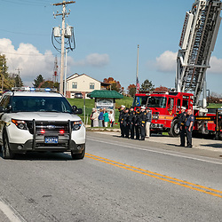 Peach Bottom, PA, USA - October 30, 2014: Pennsylvania State Police escort the funeral procession of fire apparatus for a fallen volunteer firefighter.