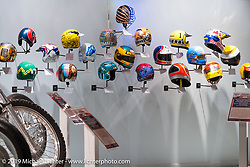 """21-Helmets"" from See See Motor Coffee in Portland with the help of Bell Helmets in the ""Built for Speed"" exhibition curated by Michael Lichter and Paul D'Orleans in the Russ Brown Events Center as part of the annual ""Motorcycles as Art"" series at the Sturgis Buffalo Chip during the Black Hills Motorcycle Rally. SD, USA. August 7, 2014.  Photography ©2014 Michael Lichter."