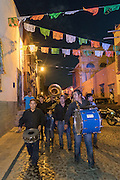 A marching band leads a Day of the Dead festival parade through the historic district in San Miguel de Allende, Guanajuato, Mexico. The week-long celebration is a time when Mexicans welcome the dead back to earth for a visit and celebrate life.