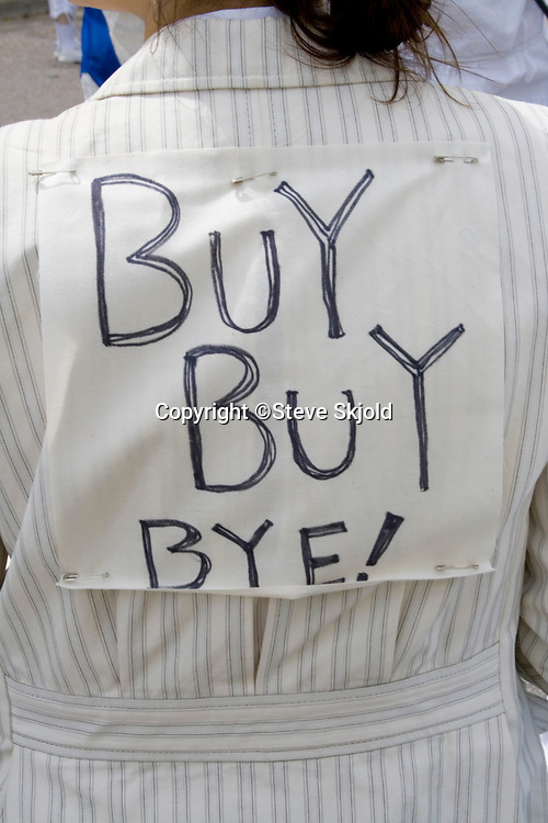 Buy sign reflecting event slogan protesting purchase of bottled water.  MayDay Parade and Festival. Minneapolis Minnesota USA
