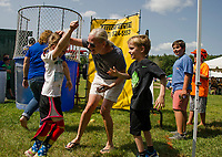Rory McShane gets a high five from her mother Sarah and twin brother Kip at the Cal Ripken dunking booth during Gilford Old Home Day festivities on Saturday.  (Karen Bobotas/for the Laconia Daily Sun)