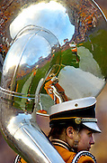 Jackie Wisniewski's Tuba shows a reflection of the filed as she stands on the sidelines moments before the LSU tiger band steps onto the field to perform their halftime show Saturday as the LSU Tigers hosted Arizona Sept. 9, 2006 in Tiger Stadium...