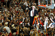 MORNING JOURNAL/DAVID RICHARD.Ohio State head coach Thad Matta holds up a piece of the net after the Buckeyes defeated visiting Wisconsin Sunday, Feb. 25, 2007, in Columbus, Ohio. Ohio State beat Wisconsin 49-48.