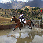 Michelle Coombes riding KC11in action at the water jump during the Cross Country event at the Wakatipu One Day Horse Trials at the Pony Club grounds,  Queenstown, Otago, New Zealand. 15th January 2012. Photo Tim Clayton
