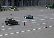 NORTH KOREA:<br /> The pictures Kim Jong Un doesn't want you to see<br /> <br /> Since 2008, Eric Lafforgue ventured to North Korea six times. Thanks to digital memory cards, I was able to save photos that I was forbidden to take or was told to delete by the minders.<br /> <br /> Photo Shows:  As cars have become more widespread in Pyongyang, the peasants are still getting accustomed to seeing them. Kids play in the middle of the main avenues just like before when there were no cars in sight.<br /> ©Eric Lafforgue/Exclusivepix Media