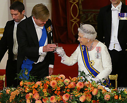 Queen Elizabeth II makes a toast during a State Banquet for the State visit by King Willem-Alexander and Queen Maxima of the Netherlands, at Buckingham Palace, London.