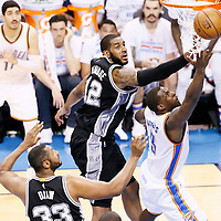 08 May 2016: Oklahoma City Thunder guard Dion Waiters (3) goes for the layup past San Antonio Spurs forward LaMarcus Aldridge (12) and San Antonio Spurs center Boris Diaw (33) during the Oklahoma City Thunder 111-97 victory over the San Antonio Spurs, during Game Four of the Western Conference Semifinals of the NBA Playoffs at the Chesapeake Energy Arena, Oklahoma City, Oklahoma, USA.