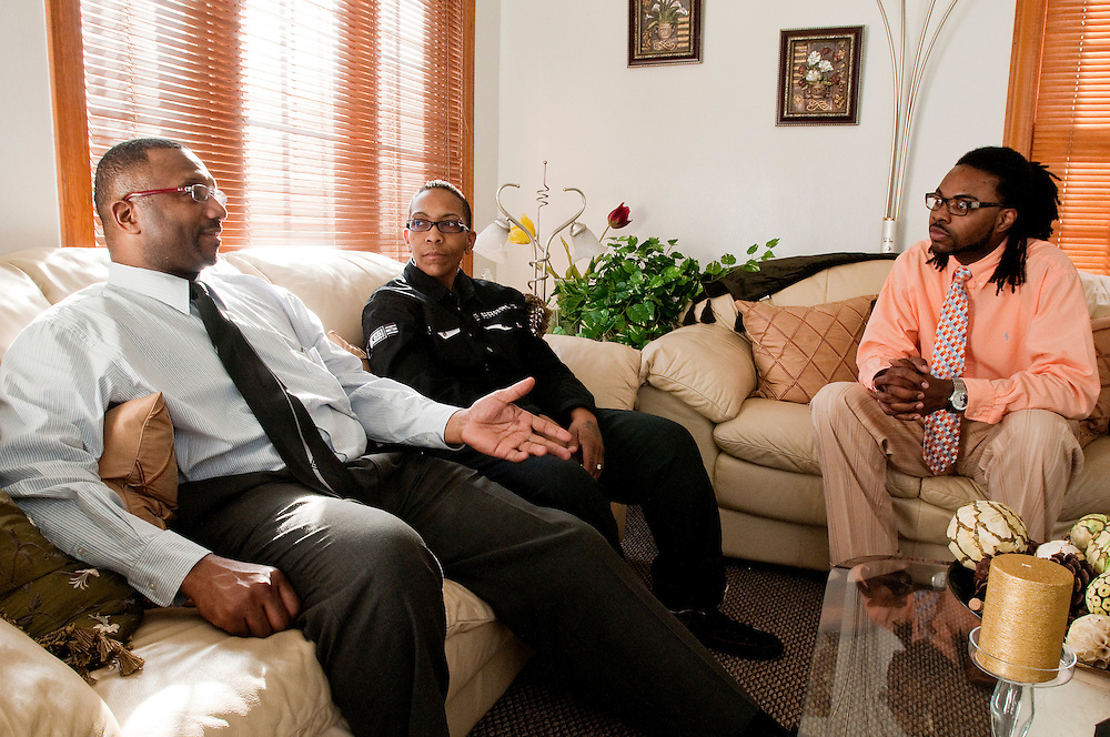 Matt Dixon | The Flint Journal..From left, Eric Majied 48, Academic Manager at Job Core and owner of Majied Enterprises, Jacqueline Witherspoon, 47, Band Director at Beecher High School, and Blake Odum, 21, a Faculty member at West Wood Elementary School discuss the new Flint all-city marching band at Witherspoon's home in Flint Wednesday evening. The band, founded by Odum and directed by Witherspoon and Majied, is open to musicians from all middle and high schools in the Flint area. The first practice will be held at Beecher High School on April 26th.