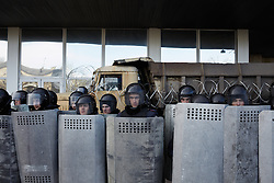 © Licensed to London News Pictures. 08/03/2014. Ukraine. Riot police guard the administrative building in Donetsk during a demonstration involving groups of pro-Russia and anti-Putin protestors, in the wake of events in Kyiv.  Photo credit : Christopher Nunn/LNP