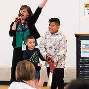 Principal Lindsay Garcia celebrates after students cut the ribbon during a ceremony in the new gymnasium at Eastwood Elementary School in Hillsboro, Ore., on Tuesday, Feb. 4, 2020.