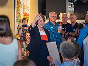 25 MAY 2019 - IOWA FALLS, IOWA: US Senator AMY KLOBUCHAR (D-MN), left, waves to the crowd as she walks into a campaign event in Iowa Falls. Sen. Klobuchar is touring Iowa this weekend to support her bid to be the Democratic nominee in 2020 for the US Presidency. Iowa traditionally hosts the the first election event of the presidential election cycle. The Iowa Caucuses will be on Feb. 3, 2020.         PHOTO BY JACK KURTZ
