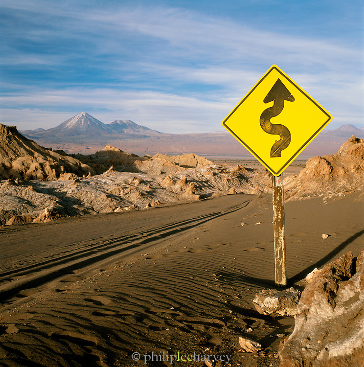 Road in 'Valle De La Luna' Surrounded By Mountains In The Atacama Desert, San Pedro, Chile