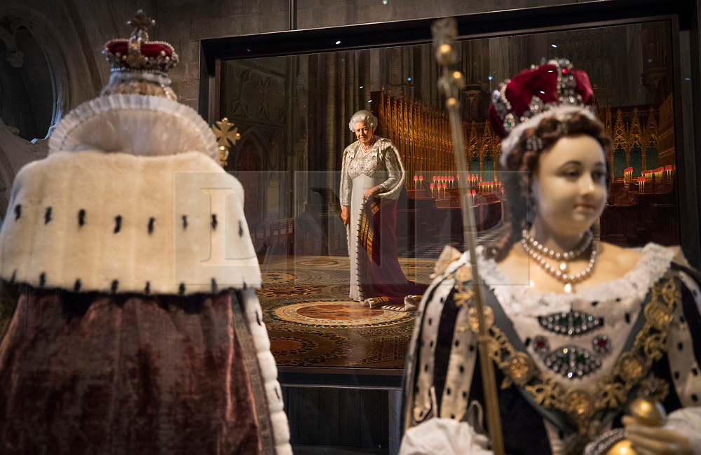 © Licensed to London News Pictures. 29/05/2018. London, UK.  Ralph Heimans' 2012 painting 'The Coronation Theatre: Portrait of Her Majesty Queen Elizabeth II' looks down over funeral effigies of Queen Anne (L) and Queen Elizabeth I in the new Queen's Diamond Jubilee Galleries at Westminster Abbey. The recently finished galleries situated in 13th century triforium, 52 feet above the abbey floor, will display treasures not seen by the public before and tell the story of abbey's thousand-year history. Photo credit: Peter Macdiarmid/LNP