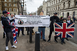 London, UK. 31 January, 2020. Brexit supporters seek to antagonise pro-EU activists preparing to hold a procession from outside Downing Street to Europe House, the location for the European Commission in London, on the occasion of Brexit Day.