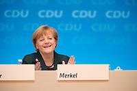 09 DEC 2014, KOELN/GERMANY:<br /> Angela Merkel, CDU, Bundeskanzlerin, CDU Bundesparteitag, Messe Koeln<br /> IMAGE: 20141209-01-155<br /> KEYWORDS: Party Congress, klatscht, applaudiert, Applaus, freundlich, lacht