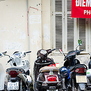 Motor scooters parked outside colonial building on Old Quarter Hanoi