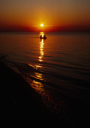 Couple canoeing Florida Bay at sunrise, Cape Sable, Everglades National Park, Florida.