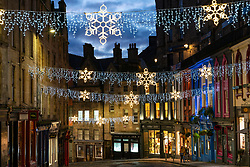 Edinburgh, Scotland, UK. 26 November 2020.Night views of Edinburgh as Christmas approaches.  View of Christmas lights in Victoria Street in Edinburgh's Old Town.  Credit.  Iain Masterton/Alamy Live News