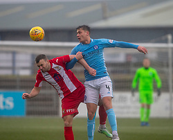 East Fife's Kevin Smith and Forfar Athletic's Darren Whyte. Forfar Athletic 3 v 0 East Fife, Scottish Football League Division One game played 2/3/2019 at Forfar Athletic's home ground, Station Park, Forfar.