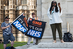 London, UK. 20th July, 2021. Dawn Butler, Labour MP for Brent Central, addresses NHS workers from the grassroots NHSPay15 campaign outside Parliament before a march to 10 Downing Street to deliver a petition signed by over 800,000 people calling for a 15% pay rise for NHS workers. At the time of presentation of the petition, the government was believed to be preparing to offer NHS workers a 3% pay rise in 'recognition of the unique impact of the pandemic on the NHS'.