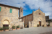 The main piazza in Monteriggioni, a small medieval, hill top town in Tuscany, Italy