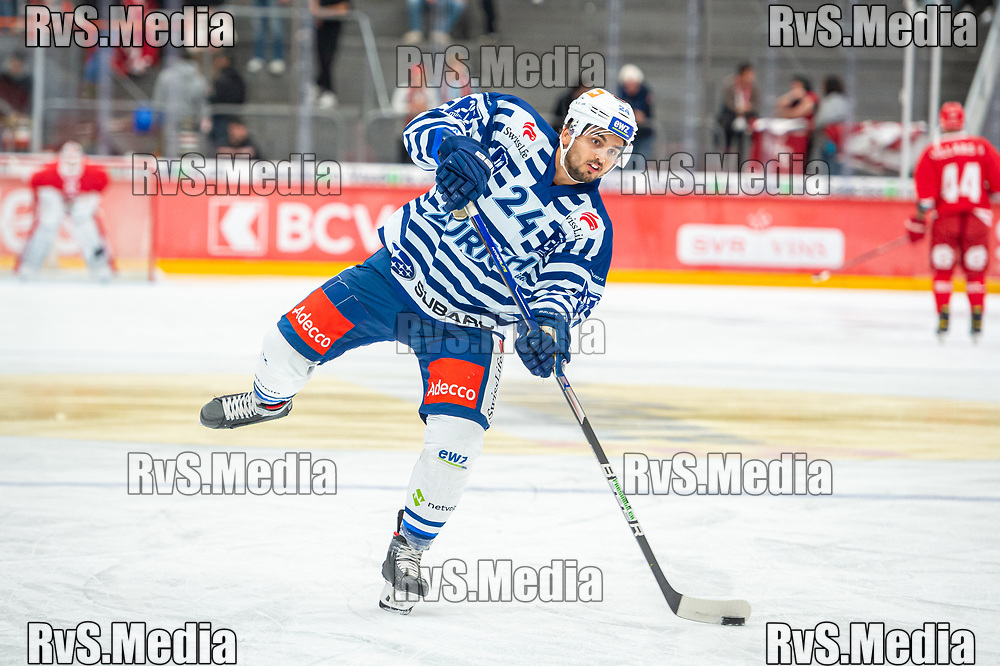 LAUSANNE, SWITZERLAND - OCTOBER 01: Phil Baltisberger #24 of ZSC Lions warms up prior the Swiss National League game between Lausanne HC and ZSC Lions at Vaudoise Arena on October 1, 2021 in Lausanne, Switzerland. (Photo by Monika Majer/RvS.Media)