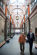 """Royal Arcade was constructed in 1879 and connects Old Bond Street with Albemarle Street. It has a saddled glass roof. It was originally simply called """"The Arcade"""", but since the shirtmaker H. W. Brettell was patronised by Queen Victoria, it was renamed as the """"Royal Arcade"""". Number 12 now houses the luxury perfume house Ormonde Jayne. The arcade also houses Charbonnel et Walker, a long-time royal warrant holder and one of the original arcade tenants."""