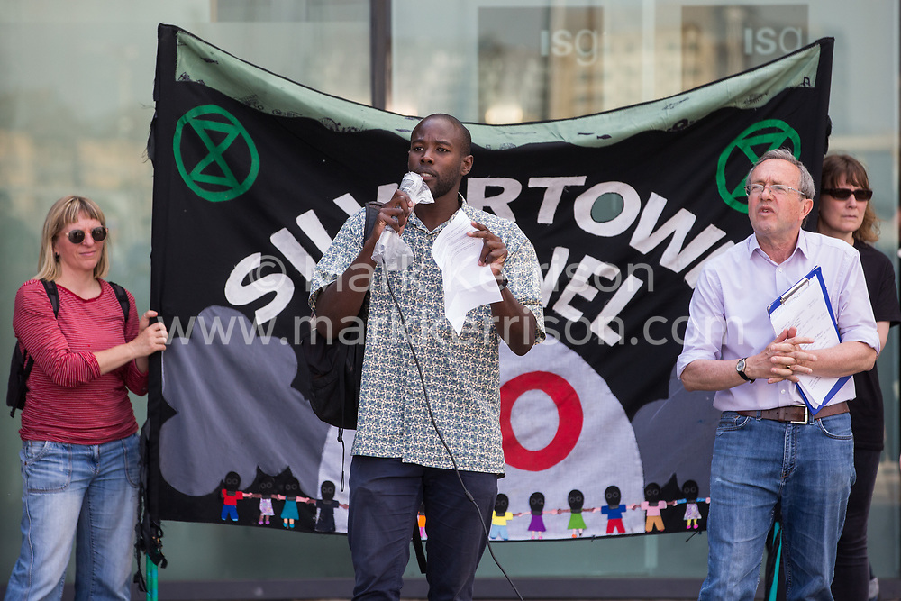 London, UK. 5th June, 2021. Joshua Williams of London Young Greens addresses environmental activists and local residents protesting against the construction of the Silvertown Tunnel. Campaigners opposed to the controversial new £2bn road link across the River Thames from the Tidal Basin Roundabout in Silvertown to Greenwich Peninsula argue that it is incompatible with the UK's climate change commitments because it will attract more traffic and so also increased congestion and air pollution to the most polluted borough of London.