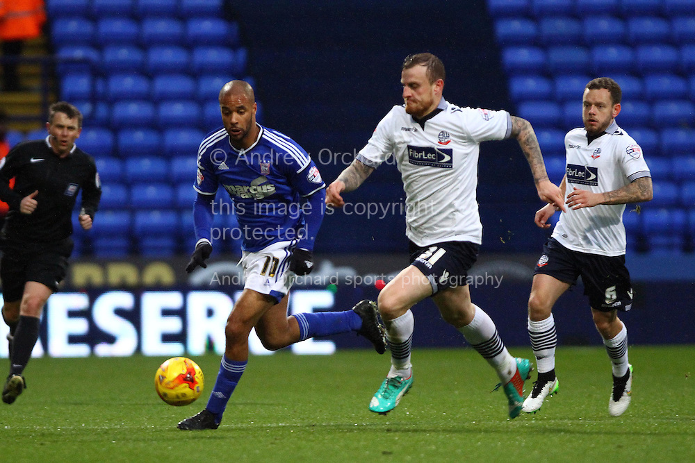 David McGoldrick of Ipswich Town and David Wheater of Bolton Wanderers chase the ball. Skybet football league championship match, Bolton Wanderers v Ipswich Town at the Macron stadium in Bolton, Lancs on Saturday 13th December 2014.<br /> pic by Chris Stading, Andrew Orchard sports photography.