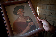 """Lashawna Etheridge-Bey, a 39-year-old resident of Washington, DC, spent half of her life in prison for a double murder. She was paroled in December 2011. While visiting her mother's house, she finds a photograph of her self from before her incarceration. """"I was one of the worst people you would probably ever meet,"""" says Lashawna of her life when she was nineteen.<br /> (photo by Gabriela Bulisova)"""